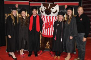 Katie Bock, Jessica Dercks, Cody Getschel, Bucky Badger, Bethany Dado, Erica Ballmer and Ted Halbach, Faculty Associate in Dairy Management